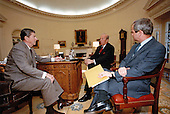 United States President Ronald Reagan, left, meets US Secretary of State George Schultz, center, and Robert McFarlane, Assistant to the President for National Security Affairs, right, in the Oval Office of the White House in Washington, DC on November 14, 1984.<br /> Mandatory Credit: Jack Kightlinger / White House via CNP
