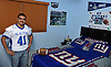 Victor Gamarra, Copiague High School football player and avid New York Giants fan, poses for a portrait inside the bedroom of his home on Wednesday, Dec. 12, 2018.