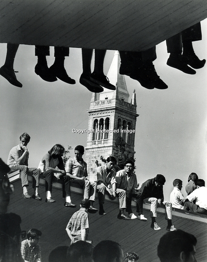 Students sitting atop rooftops around Sproul Plaza during the 60's at U.C. Berkeley.(photo copyright Ron Riesterer)