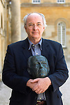 Philip Pullman at Blenheim Palace during the Woodstock Literary Festival, Woodstock, Oxfordshire, UK. 17 September 2010. He is holding a bronze of himself by the sculptor Martin Jennings. Photograph copyright Graham Harrison.