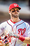 25 July 2013: Washington Nationals outfielder Bryce Harper returns to the dugout during a game against the Pittsburgh Pirates at Nationals Park in Washington, DC. The Nationals salvaged the last game of their series, winning 9-7 ending their 6-game losing streak. Mandatory Credit: Ed Wolfstein Photo *** RAW (NEF) Image File Available ***
