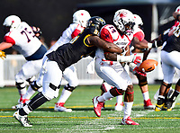Baltimore, MD - OCT 14, 2017: Towson Tigers linebacker Diondre Wallace (56) knocks the ball out of the hands of Richmond Spiders wide receiver Cortrelle Simpson (14) during game between Towson and Richmond at Johnny Unitas Stadium in Baltimore, MD. The Spiders defeated the Tigers 23-3. (Photo by Phil Peters/Media Images International)