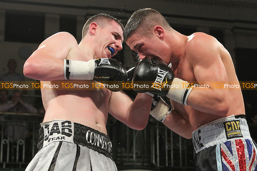 Ronnie Heffron (black shorts) defeats Peter McDonagh in a Welterweight boxing contest at York Hall, Bethnal Green, London, promoted by Frank Warren - 01/11/12 - MANDATORY CREDIT: Gavin Ellis/TGSPHOTO - Self billing applies where appropriate - 0845 094 6026 - contact@tgsphoto.co.uk - NO UNPAID USE.