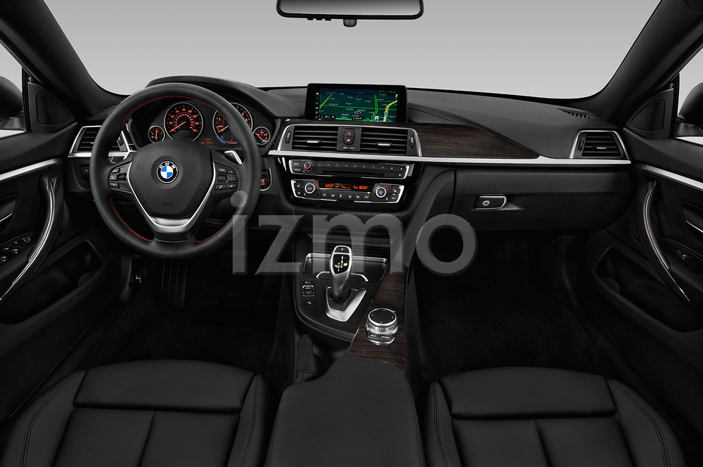 Stock photo of straight dashboard view of a 2020 BMW 4 Series 430i Gran Coupe 5 Door Hatchback