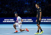 Lukasz Kubot of Poland (left) and Marcelo Melo of Brazil celebrate their victory over Ivan Dodig of Croatia and Marcel Granollers of Spain - Kubot/Melo def Dodig/Granollers 7-6, 6-4<br /> <br /> Photographer Ashley Western/CameraSport<br /> <br /> International Tennis - Nitto ATP World Tour Finals - O2 Arena - London - Day 2  - Monday 13th November 2017<br /> <br /> World Copyright &not;&copy; 2017 CameraSport. All rights reserved. 43 Linden Ave. Countesthorpe. Leicester. England. LE8 5PG - Tel: +44 (0) 116 277 4147 - admin@camerasport.com - www.camerasport.com