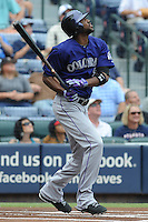 Colorado Rockies center fielder Dexter Fowler #24 swings at a pitch during a game against the Atlanta Braves at Turner Field on September 3, 2012 in Atlanta, Georgia. The Braves  defeated the Rockies 6-1. (Tony Farlow/Four Seam Images).