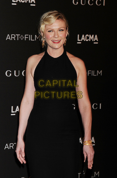 LOS ANGELES, CA - NOVEMBER 01: Actress Kirsten Dunst attends the 2014 LACMA Art + Film Gala honoring Barbara Kruger and Quentin Tarantino presented by Gucci at LACMA on November 1, 2014 in Los Angeles, California.<br /> CAP/ROT/TM<br /> &copy;Tony Michaels/Roth Stock/Capital Pictures