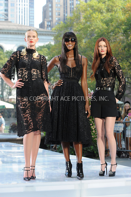 WWW.ACEPIXS.COM<br /> September 11, 2013 New York City<br /> <br /> Anne Vyalitsyna, Naomi Campbell and Lydia Hearst  taping a segment for 'The Face' in Bryant Park on September 11, 2013 in New York City.<br /> <br /> By Line: Kristin Callahan/ACE Pictures<br /> <br /> ACE Pictures, Inc.<br /> tel: 646 769 0430<br /> Email: info@acepixs.com<br /> www.acepixs.com<br /> Copyright:<br /> Kristin Callahan/ACE Pictures