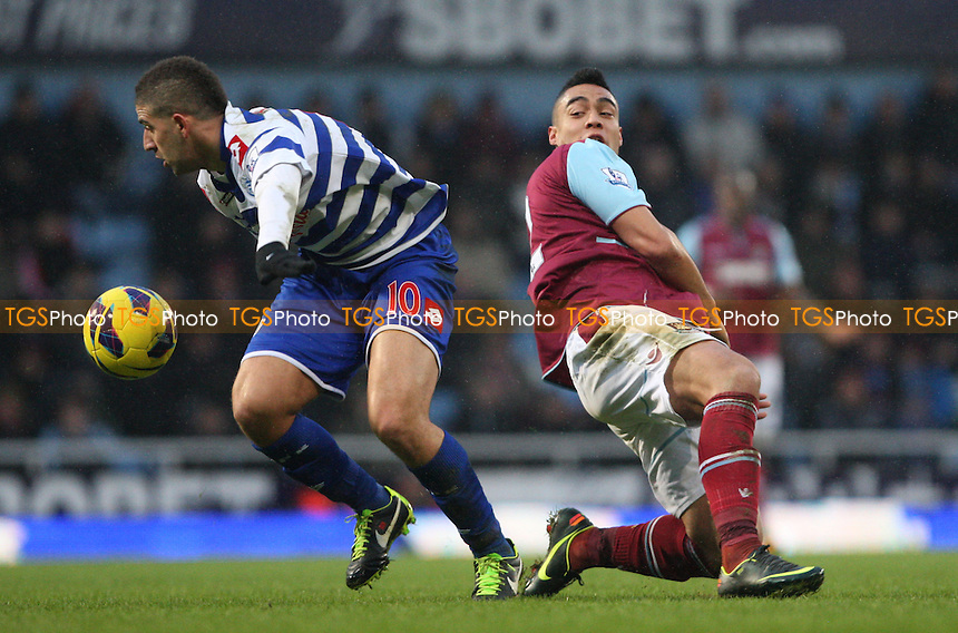 Adel Taarabt of QPR and Winston Reid of West Ham - West Ham United vs Queens Park Rangers, Barclays Premier League at Upton Park, West Ham - 19/01/13 - MANDATORY CREDIT: Rob Newell/TGSPHOTO - Self billing applies where appropriate - 0845 094 6026 - contact@tgsphoto.co.uk - NO UNPAID USE.