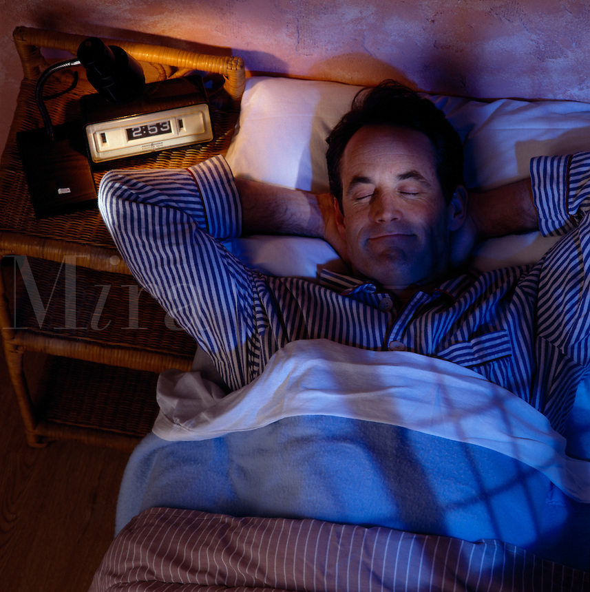 Man in bed at night.
