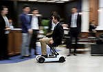 """March 9 2017, Tokyo, Japan - Yosuke Takahashi, executive of Takahashi Seigawara demonstrates the prototype model of a foldable electric wheelchair """"Scoo"""" which enables to carry into the plane at a presentation of All Nippon Airways (ANA) crowdfunding """"WonderFLY"""" in Tokyo on Thursday, March 9, 2017. The unique electric wheelchair is developed with Daido University professor Takashi Ifuji.    (Photo by Yoshio Tsunoda/AFLO) LwX -ytd-"""