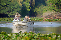 Tourists searching for jaguars and other wildlife in a lagoon off the Cuiaba River. Porto Jofre, northern Pantanal, Mato Grosso State, Brazil.