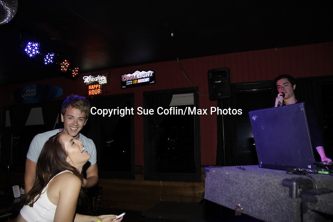 Chad Duell & Kristen Alderson - General Hospital watch Eddie Alderson sing at 15th Southwest Florida Soapfest 2014 Charity Weekend with a Bartending/Karaoke get together on May 26, 2104 at Porky's, Marco Island, Florida. (Photo by Sue Coflin/Max Photos)