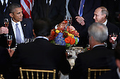 United States President Barack Obama (L) and President Valdimir Putin of Russia toast during a luncheon hosted by United Nations Secretary-General Ban Ki-moon during the 70th annual UN General Assembly at the UN headquarters September 28, 2015 in New York City. Obama held a bilateral meeting with Indian Prime Minister Narendra Modi and will have a face-to-face meeting with Putin later in the day. <br /> Credit: Chip Somodevilla / Pool via CNP