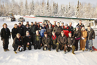 "February 16, 2013  Iditarod Air Force pilots and logistics volunteers pose for a photo at the Willow airport during the first day of the ""Food Fly"" activities.  This is where musher's food bags, straw, HEET and people food is flown by the Iditarod Air Force to the 4 checkpoints on the east side the Alaska Range. ..Iditarod 2013   Photo Copyright Jeff Schultz  -- Do not reproduce without written permission"
