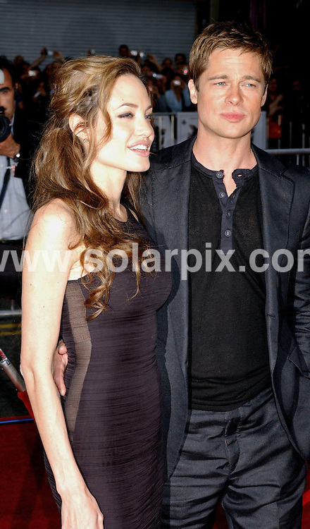 **ALL ROUND PICTURES FROM SOLARPIX.COM**.**WORLDWIDE SYNDICATION RIGHTS EXCLUDING - FRANCE** .Brad Pitt and Angelina Jolie arrive at the premiere of his film, OCEAN'S 13  in Hollywood, Ca. at Grauman's Chinese Theater. USA..JOB REF: 4037    GLS       DATE: 05/06/07.**MUST CREDIT SOLARPIX.COM OR DOUBLE FEE WILL BE CHARGED* *UNDER NO CIRCUMSTANCES IS THIS IMAGE TO BE REPRODUCED FOR ANY ONLINE EDITION WITHOUT PRIOR PERMISSION*