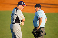 American Legion Manager Byron Ballard #19 discuss a call with the home plate umpire during the game against RBI at the 2011 Tournament of Stars at the USA Baseball National Training Center on June 25, 2011 in Cary, North Carolina.  RBI defeated American Legion by the score of 8-7. (Brian Westerholt/Four Seam Images)