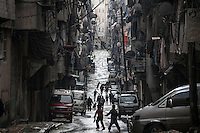 In this Tuesday, Dec. 04, 2012 photo, night falls in a crowded street in Zucari neighborhood, Aleppo. (AP Photo/Narciso Contreras)