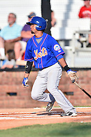 Kingsport Mets second baseman Luis Carpio (11) swings at a pitch during a game against the  Johnson City Cardinals on June 25, 2015 in Johnson City, Tennessee. The Mets defeated the Cardinals 10-8 (Tony Farlow/Four Seam Images)