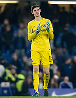 Goalkeeper Thibaut Courtois of Chelsea applauds the support during the Carabao Cup semi final 1st leg match between Chelsea and Arsenal at Stamford Bridge, London, England on 10 January 2018. Photo by Andy Rowland.