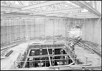 BNPS.co.uk (01202 558833)<br /> Pic: FAST<br /> <br /> Construction work in progress in the early 1950's.<br /> <br /> Sci-fi 'Centrifuge' to open its doors to the public after 64 years...<br /> <br /> A remarkable Cold War relic which has put thousands of pilots through their G-force paces has made its final spin after six decades. <br /> <br /> The Top Secret building at the former RAE Farnborough test site is now open to the public for guided tours led by the scientists from FAST who used to work there.<br /> <br /> The Farnborough Centrifuge was used to simulate huge 9G forces - nine times more than a human body is designed to absorb - they would encounter while flying fast jets during combat operations.<br /> <br /> The pilot would sit in a small compartment replicating a cockpit at the end of the 60ft rotating arm and be propelled at over 60mph, spinning 30 times a minute.<br /> <br /> A staggering 122,133 tests were performed on it before it was decommissioned in March this year, with a new centrifuge installed at RAF Cranwell.<br /> <br /> It featured on an episode of Top Gear in 2000 when Jeremy Clarkson had a go on it at 3G, leaving him in obvious discomfort. He described the force exerted on him as like 'having an elephant sat on my chest'.<br /> <br /> The centrifuge, which is being displayed for the public for the first time, also appeared in the 1985 comedy film Spies Like Us starring Chevy Chase and Dan Ackroyd.
