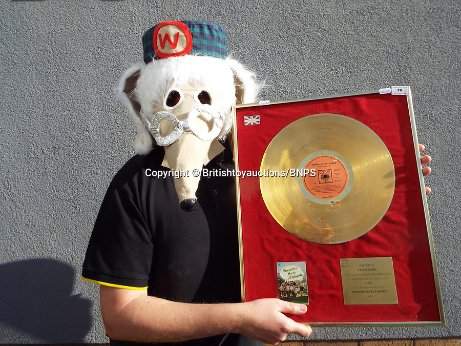 BNPS.co.uk (01202 558833)<br /> Pic: BritishToyAuctions/BNPS<br /> <br /> A  CBS records gold disc for Remeber you're a Womble<br /> <br /> An environmentalist is selling the world's biggest Womble collection after the famous furry creatures inspired her to save the planet as a child.Gill Seyfang, a senior lecturer in Sustainable Consumption at the University of East Anglia, owns over 1,700 items relating the furry creatures.Her vast collection ranges from soft toys to rubbish bins and was recognised by the Guinness Book of Records in 2016.
