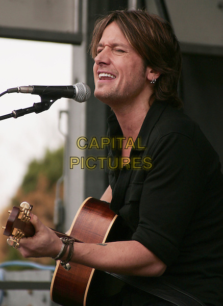 KEITH URBAN.performs a free acoustic set at the Verizon Wireless Store, Cool Springs, Tennessee, USA, .30th October 2009..music concert gig live on stage performing half length guitar microphone black top shirt singing playing side profile                    .CAP/ADM/EM.©Eddie Malone/Admedia/Capital Pictures