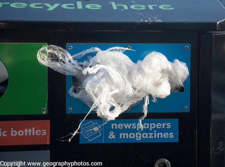 Rubbish litter recycling bins with polythene in wrong place being misused, UK