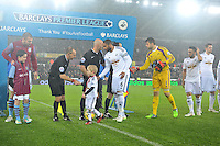 Pictured: Friday 26 December 2014<br /> Re: Premier League, Swansea City FC v Aston Villa at the Liberty Stadium, Swansea, south Wales, UK.<br /> <br /> Swansea and Aston Villa players and mascots shake hands