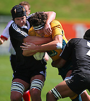 Kane Bennett tackles Nick Buchanan during the International rugby match between New Zealand Secondary Schools and Suncorp Australia Secondary Schools at Yarrows Stadium, New Plymouth, New Zealand on Friday, 10 October 2008. Photo: Dave Lintott / lintottphoto.co.nz