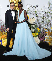 HOLLYWOOD, LOS ANGELES, CA, USA - MARCH 02: Christoph Waltz, Lupita Nyong'o at the 86th Annual Academy Awards - Press Room held at Dolby Theatre on March 2, 2014 in Hollywood, Los Angeles, California, United States. (Photo by Xavier Collin/Celebrity Monitor)