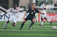 Nick Palodichuk controls the ball ahead of Kevin Hanganda. US Men's National Team Under 17 defeated Malawi 1-0 in the second game of the FIFA 2009 Under-17 World Cup at Sani Abacha Stadium in Kano, Nigeria on October 29, 2009.