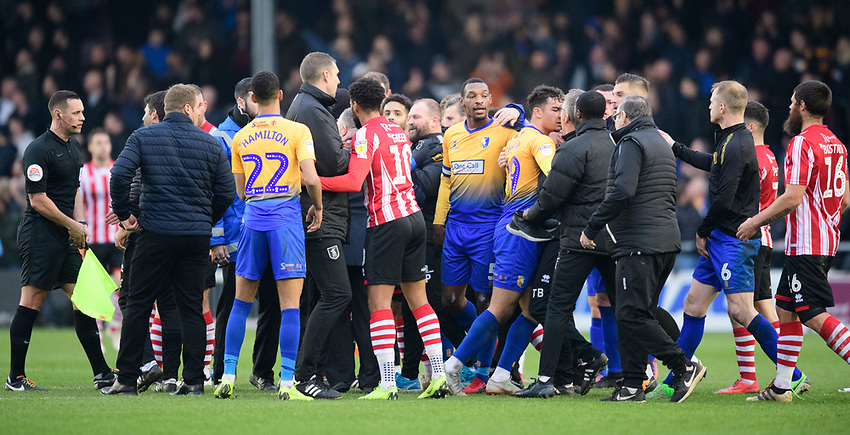 Tempers appear to threaten over at the end of the game<br /> <br /> Photographer Chris Vaughan/CameraSport<br /> <br /> The EFL Sky Bet League Two - Lincoln City v Mansfield Town - Saturday 24th November 2018 - Sincil Bank - Lincoln<br /> <br /> World Copyright © 2018 CameraSport. All rights reserved. 43 Linden Ave. Countesthorpe. Leicester. England. LE8 5PG - Tel: +44 (0) 116 277 4147 - admin@camerasport.com - www.camerasport.com