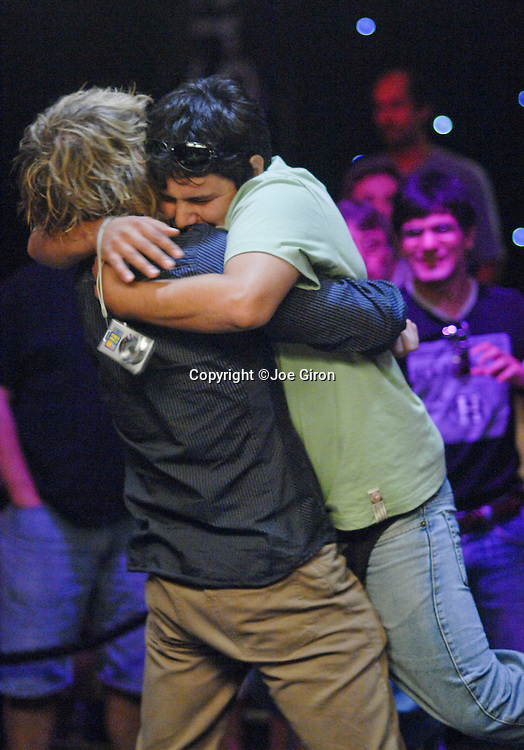 Karl Hevroy gets a hug from a friend after winning the LAPT Season 2 Punta del Este Event.