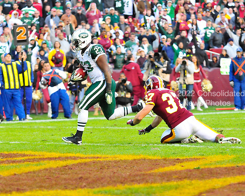 New York Jets running back Shonn Greene (23) runs for a touchdown, beating Washington Redskins safety Reed Doughty (37) late in the fourth quarter at FedEx Field in Landover, Maryland on Sunday, December 4, 2011.  The Jets won the game 34 - 19..Credit: Ron Sachs / CNP.(RESTRICTION: NO New York or New Jersey Newspapers or newspapers within a 75 mile radius of New York City)