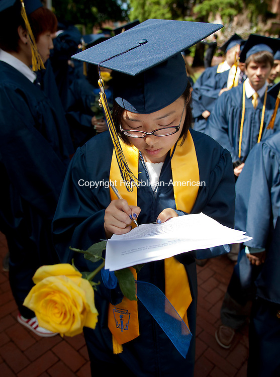 CHESHIRE, CT-8 June 2013-060813BF06-   Salutatorian Nianci Li,19, from Shanghai, China, makes some last  minute changes to her Salutatory Address while processing into Cheshire Academy's graduation at the campus' Kevin Slaughter Field in Cheshire. Li said she will be attending Washington University in St. Louis. Bob Falcetti Republican-American