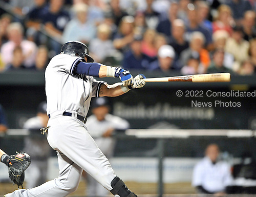 Baltimore, MD - September 1, 2009 -- New York Yankees left fielder Nick Swisher (33) hits a 2 run home run in the seventh inning against the Baltimore Orioles at Oriole Park at Camden Yards in Baltimore, MD on Tuesday, September 1, 2009.  The Yankees won the game 9 - 6..Credit: Ron Sachs / CNP.(RESTRICTION: NO New York or New Jersey Newspapers or newspapers within a 75 mile radius of New York City)
