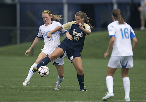 September 01, 2013:  Notre Dame midfielder Glory Williams (10) and UCLA midfielder Samantha Mewis (22) battle for the ball during NCAA Soccer match between the Notre Dame Fighting Irish and the UCLA Bruins at Alumni Stadium in South Bend, Indiana.  UCLA defeated Notre Dame 1-0.