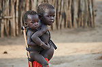 A girl carries her younger sibling on her back in the Doro Refugee Camp in Maban County, South Sudan. Doro is one of four camps in Maban that together shelter more than 130,000 refugees from the Blue Nile region of Sudan.