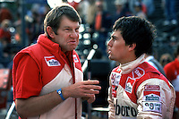 LONG BEACH, CA - MARCH 15: Tyler Alexander, chief engineer and a team director for Team McLaren, speaks with driver Andrea de Cesaris before practice for the 6th United States Grand Prix West FIA Formula One World Championship race at the temporary Long Beach Street Circuit in Long Beach, California, on March 15, 1981.