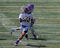 Troy Reh (#10) engages in the attack as TD Ierlan (#3) carries a faceoff win behind him.  UAlbany Lacrosse defeats Vermont 14-4  in the American East Conference Championship game at Casey Stadium, May 5.