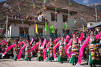 East Village, Diqing Tibetan Autonomous Prefecture, Yunnan Province, China - Tibetan women in traditional costumes perform Xianzi Dance, February 2017.