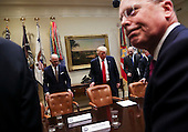 United States President Donald Trump (C) arrives for a listening session with health insurance company CEO's, among them Stephen Hemsley CEO's of United Health (R) and Dan Hilferty CEO's of Independence Blue Cross (2L), in the Roosevelt Room of the White House, Washington, DC, February 27, 2017. <br /> Credit: Aude Guerrucci / Pool via CNP