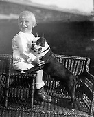 Ann Arbor, MI - FILE --  Gerald Ford with his pet Boston Terrier. Different sources identify the dog as either Spot or Fleck.  Date: ca. 1916<br /> Credit: Courtesy Gerald R. Ford Library via CNP
