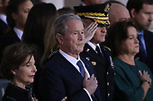 WASHINGTON, DC - DECEMBER 03: Former U.S. President George W. Bush (C) and former first lady Laura Bush (C) watch as members of a military honor guard carry the casket of his father, former U.S. President George H. W. Bush, into the U.S. Capitol December 3, 2018 in Washington, DC. A state funeral for former U.S. President Bush will be held in Washington over the next three days, beginning with him lying in state in the Rotunda of the Capitol until Wednesday morning.(Photo by Win McNamee/Getty Images)