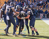 Pitt quarterback Kenny Pickett and teammates celebrate Pickett's 6-yard touchdown run.  The Pitt Panthers upset the undefeated Miami Hurricanes 24-14 on November 24, 2017 at Heinz Field, Pittsburgh, Pennsylvania.