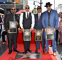 LOS ANGELES, CA. April 18, 2019: Cypress Hill, Sen Dog, DJ Muggs, Eric Bobo Correa &amp; B Real at the Hollywood Walk of Fame Star Ceremony honoring hip-hop group Cypress Hill.<br /> Pictures: Paul Smith/Featureflash