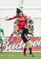 Adam Cristman #7 of D.C. United can't get up for a header against Wilman Conde #22 of the Chicago Fire during an MLS match on April 17 2010, at RFK Stadium in Washington D.C. Fire won the match 2-0.