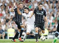 Real Madrid's Sami Khedira against Manchester City's Gareth Barry and Javi Garcia during Champions League match. September 18, 2012. (ALTERPHOTOS/Alvaro Hernandez). /NortePhoto.com<br /> <br /> **CREDITO*OBLIGATORIO** *No*Venta*A*Terceros*<br /> *No*Sale*So*third* ***No*Se*Permite*Hacer Archivo***No*Sale*So*third<br /> <br /> <br /> **CREDITO*OBLIGATORIO** *No*Venta*A*Terceros*<br /> *No*Sale*So*third* ***No*Se*Permite*Hacer Archivo***No*Sale*So*third
