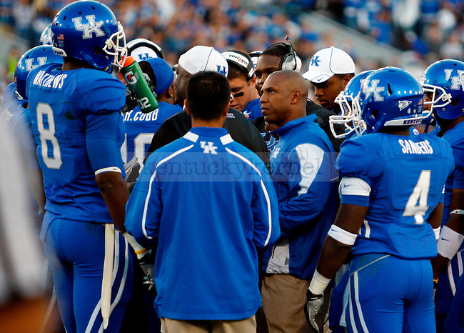 Joker Phillips talks with his players in the first half of UK's 31-28 win over  South Carolina football on Saturday, Oct. 16, 2010. Photo by Britney McIntosh | Staff